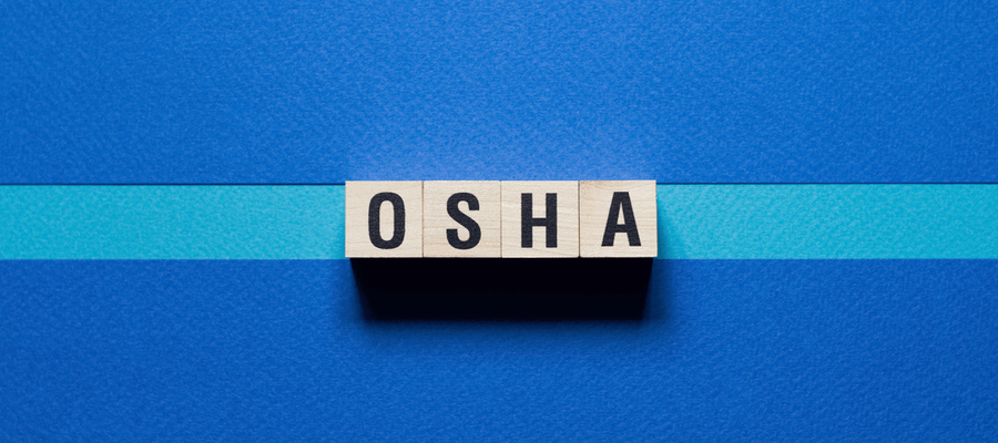 Wooden blocks on a blue background that spell out the word Osha