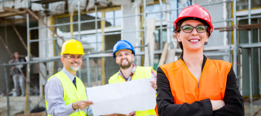 Construction woman standing in front of construction crew, OSHA competent person concept