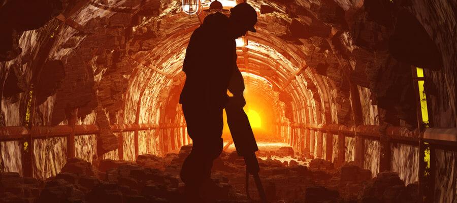 silhouette of worker in an underground mine